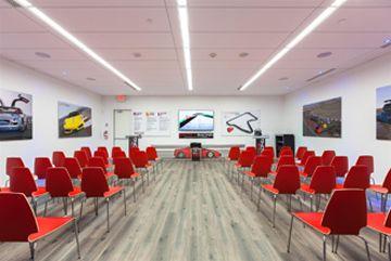 exotics racing - race car drivers briefing room